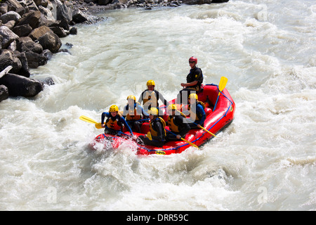 Tourists white water rafting towards Interlaken in the Bernese Oberland, Switzerland - Stock Photo