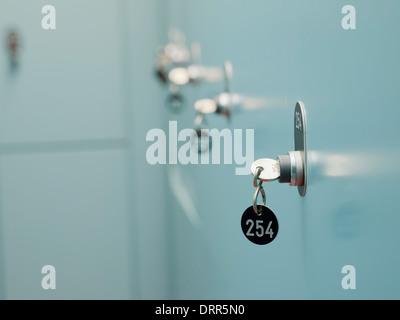 Many lockers with keys on locker room - Stock Photo