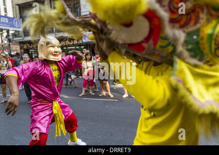 Bangkok, Thailand. 31st Jan, 2014. A Chinese Lion dance troupe performs on Yaowarat Road during Lunar New Year festivities, - Stock Photo