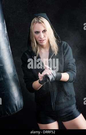 Blond boxing woman in black prepare training - Stock Photo