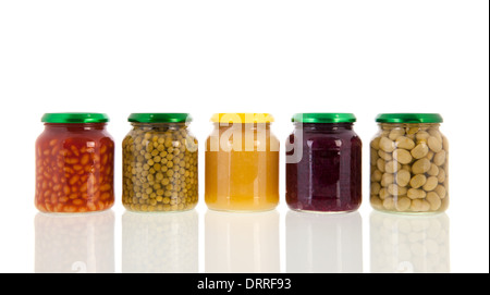 Row glass pots with canned vegetables isolated over white background - Stock Photo