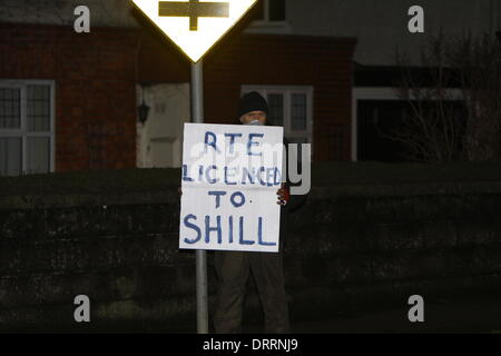 Dublin, Ireland. 31st January 2014. A protester holds a sign that reads 'RTE licenced to SHILL'. Minor scuffles - Stock Photo
