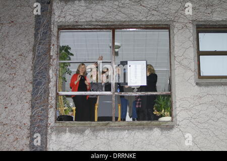 Dublin, Ireland. 31st January 2014. Hospital staff holds a sit-in in the upper floors of the hospital, looking out - Stock Photo