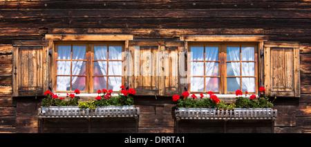 Typical Swiss style house in Serneus near Klosters in Graubunden region, Switzerland - Stock Photo