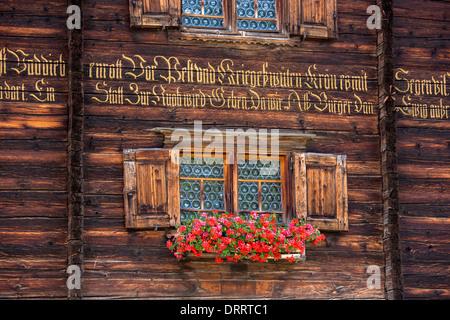 Traditional inscription on 18th Century Swiss house built 1741 in Serneus near Klosters, Graubunden region, Switzerland - Stock Photo