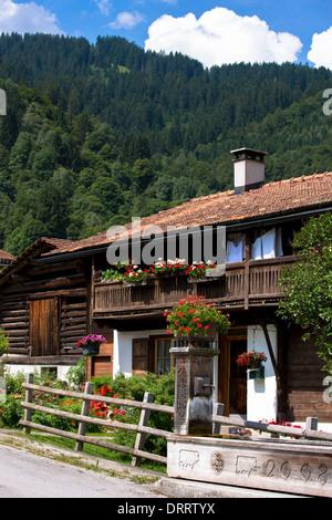 Typical Swiss wooden chalet style house in Serneus near Klosters in Graubunden region, Switzerland - Stock Photo
