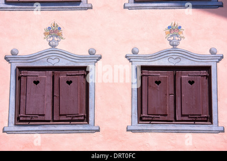 Window shutters and paint effects on a traditional 18th Century house built 1765 in Klosters in Graubunden region - Stock Photo