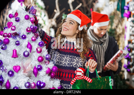Woman Shopping For Christmas Decorations - Stock Photo