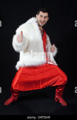 Expressive man in white fur coat. - Stock Photo