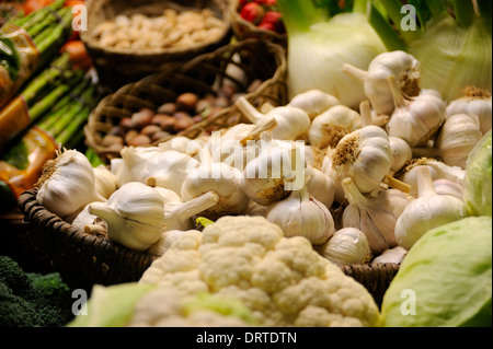 FRESH GARLIC ON SALE IN AN INDOOR MARKET IN ALICANTE SPAIN - Stock Photo