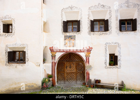 House in the Engadine Valley in the village of Guarda with old painted stone 17th Century buildings, Switzerland - Stock Photo