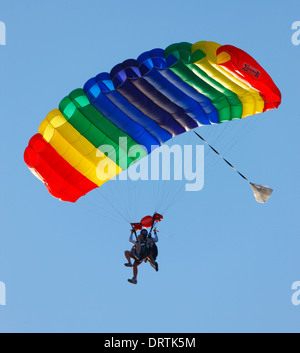 Colourful parachute.Skydivers in the air. - Stock Photo