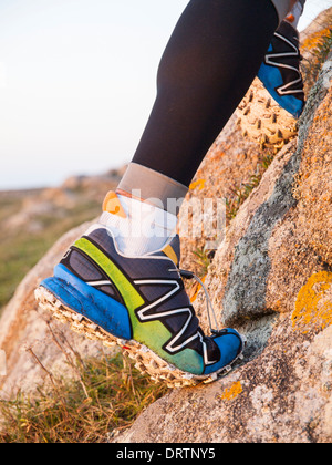 Extreme sports shoes for trail running practice in nature. - Stock Photo