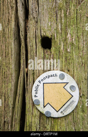 A close up photograph of a Public Footpath sign from the Worcestershire County Council, nailed to an old decaying - Stock Photo