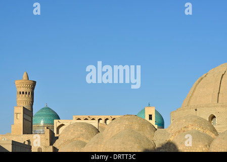Bazaar roof with Kalon Mosque and Minret in the background, Bukhara, Uzbekistan - Stock Photo