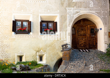 Windows in the Engadine Valley in the village of Guarda - old painted stone 17th Century buildings, Switzerland - Stock Photo