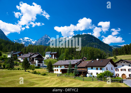 Fontana village surrounded by larch forest in the Lower Engadine Valley, Swiss Alps, Switzerland - Stock Photo