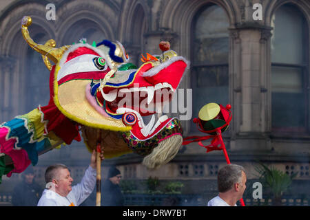 Manchester, Chinatown 2nd February, 2104.  High pole lion dance at the Chinese New Year in Albert Square, Manchester - Stock Photo