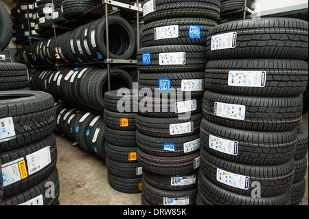 Car tires are being stored in a garage.