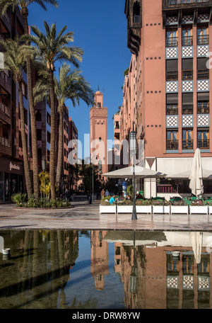 Western style offices and Mosque in Plaza at Place du 16 Novembre, Gueliz, Ville Nouvelle, Marrakech (Marrakesh) - Stock Photo