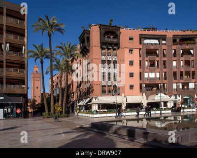Western style offices and mosque in Plaza at Place du 16 Novembre, Gueliz, Marrakech (Marrakesh) - Stock Photo