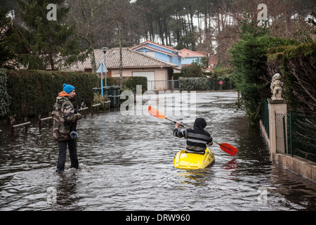 In Capbreton (Landes - France), boating on a flooded street. All opportunities are good for youngish people to have - Stock Photo