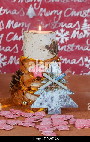 Candle holders made of birch with Christmas decoration - Stock Photo