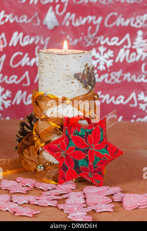 Candle holders made of birch with Christmas decoration, Star - Stock Photo