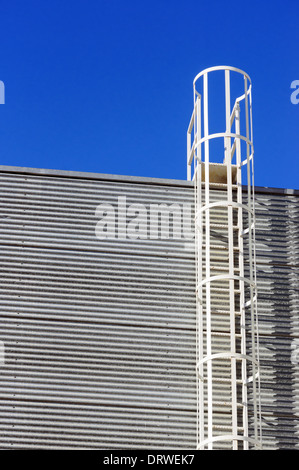 safety ladder on industrial facade - Stock Photo
