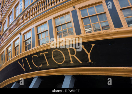 The stern of lord horatio nelsons flagship HMS Victory whis is in portsmout UK asnd open to the public - Stock Photo