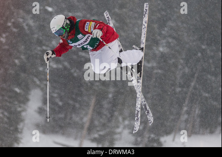 Patrick Deneen launches at FIS Freestyle Ski World Cup 2014 Moguls, Deer Valley Resort, Park City, UT, USA - Stock Photo