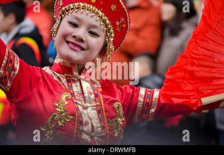 VANCOUVER, BC, CANADA, Chinatown - February 2, 2014.  A young woman performs in colourful traditional costume as - Stock Photo