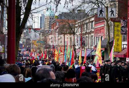 VANCOUVER, BC, CANADA - February 2, 2014.  Large crowds gather to watch the colourful Chinese New Year's Parade - Stock Photo