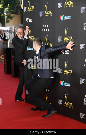 Geoffrey Rush arrives on the red carpet for the 3rd annual AACTA awards. - Stock Photo