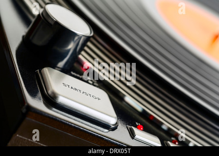 Turntable rotates and start stop button - Stock Photo