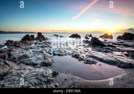 Rock pools on the beach at Looe in Cornwall - Stock Photo