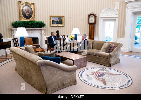 US President Barack Obama meets with Deputy Secretary of State Bill Burns in the Oval Office of the White House - Stock Photo