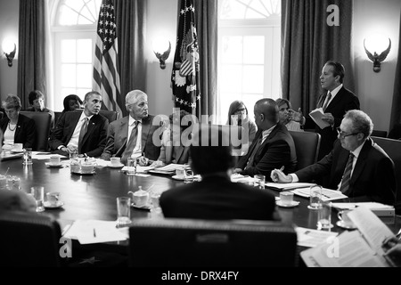 US President Barack Obama and Cabinet members listen to National Economic Council Director Gene Sperling during - Stock Photo