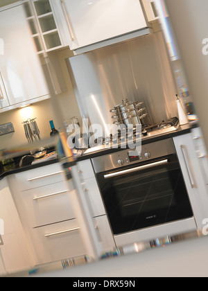 Kitchen reflected in the mirror. - Stock Photo