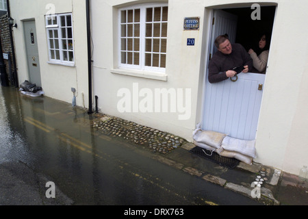 united kingdom west sussex arundel 2014 floods anxious homeowners checking the flooding - Stock Photo