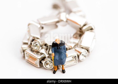 Senior sitting on jewelry - Stock Photo