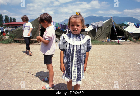 Children in swimming pool refugee camp in Tirana Albania for Kosovar refugees that fled the Kosovan war in 1999 - Stock Photo