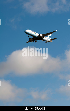 Flybe Embraer ERJ-175 approaching Birmingham Airport, UK - Stock Photo