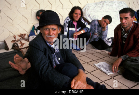 Kosovar refugees fleeing war in Kosovo at swimming pool refugee camp in 1999, Tirana, Albania - Stock Photo
