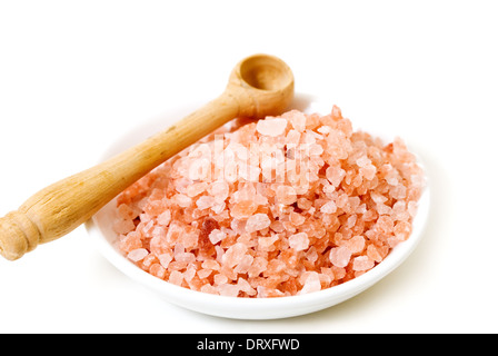 Himalayan pink rock crystal table salt with wooden scoop. - Stock Photo