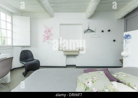 Interior of the white rustic bedroom. - Stock Photo