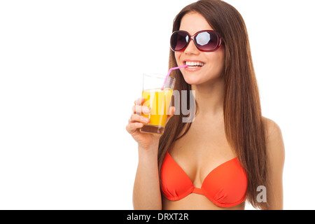 Smiling woman with sunglasses drinks orange juice in summer, isolated on white - Stock Photo