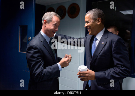 US President Barack Obama talks with Maryland Gov. Martin O'Malley backstage before delivering remarks on the Affordable - Stock Photo
