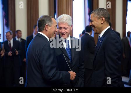 US President Barack Obama and former President Bill Clinton speak with House Speaker John Boehner before a memorial service for former House Speaker Tom Foley at the U.S. Capitol October 29, 2013 in Washington, DC.