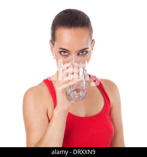 Portrait of a beautiful woman drinking a glasse of water and looking in front of her, , isolated on white - Stock Photo